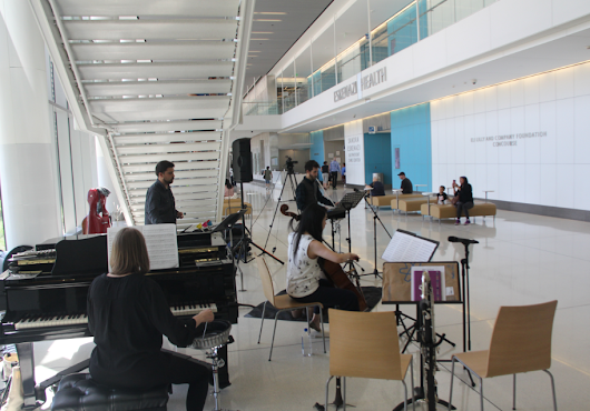Musicians performing within the Eskenazi Hospital. Photo courtesy of CBS4 Indianapolis.