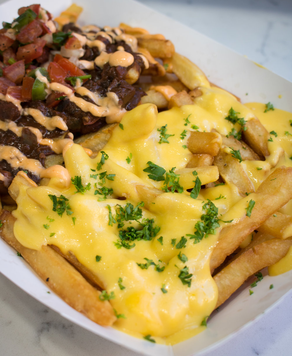 Custom order courtesy of Marty:  half cheesy fries and chili fries!