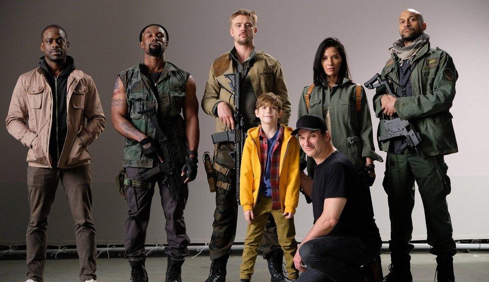 Sidebar-1-photo-The-cast-back-row-from-left-Sterling-K.-Brown-Trevante-Rhodes-Boyd-Holbrook-Olivia-Munn-Keegan-Michael-Key-front-row-Jacob-Tremblay-and-director-Shane-Black-1.jpg