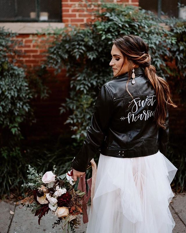 throwin' it back to bride number 9 🖤✨ @cravingcurrently was actually the first bride to reserve #thejustmarriedjacketbmore! she heard about the baltimore chapter before it even launched and i'm so glad she did. she got married at the same venue, wearing the same jacket as me!  by the end of 2019, we should reach 50 baltimore brides who have worn this jacket on their wedding day. i love the connection that the jacket has created between brides all over our city...especially because i am one of them!👰🏼 [photo: @withloveandembers | planning, design, florals: @eventiweddings]