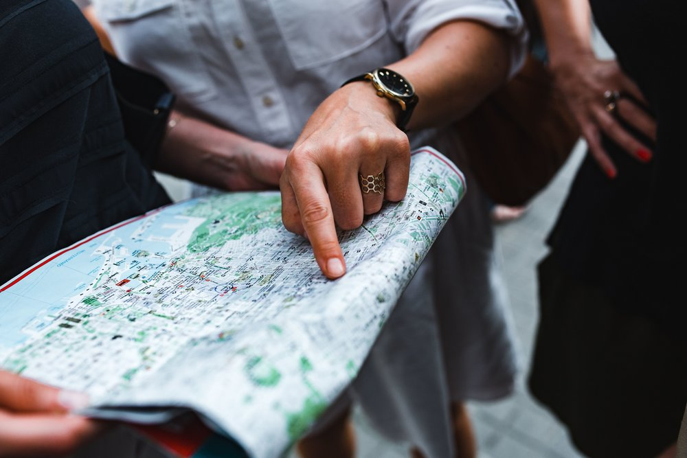 kaboompics_Group of people examining a map.jpg