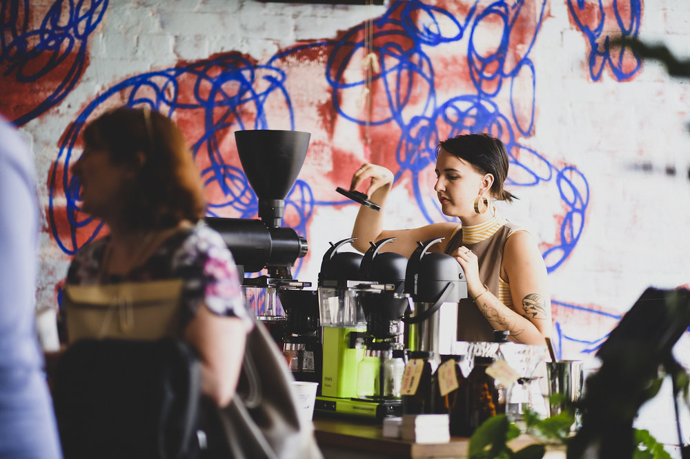 Floor-to-ceiling  Bromley -graffitied walls were the backdrop to Caitlin, one of the baristas from  Proud Mary . They lured us nose-first into the coffee cul-de-sac corner of the venue, filling it with the wafting aromas of fresh coffee. Batch brews were served throughout the afternoon at the generous  ad lib  frequency.