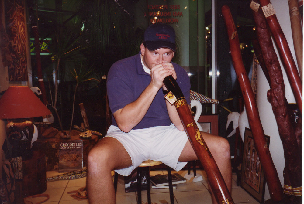 Trying out a didgeridoo