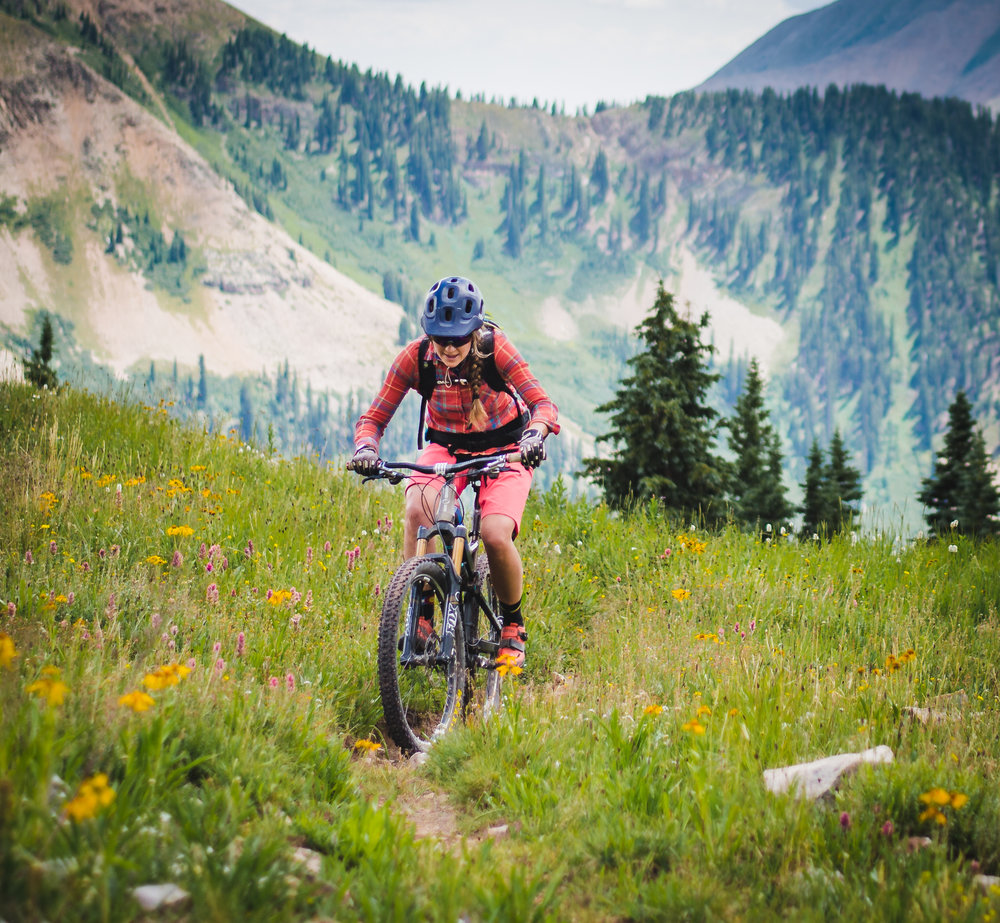 Team Director Sabina - Sabina grew up in Durango, CO and has loved mountain biking for a very long time. She started racing mountain bikes when she was in high school, and raced as a Pro when she was 18 years old. She attended Fort Lewis College and raced all disciplines of cycling (short track, xcountry, downhill, 4X, dual slalom, cyclocross, road). She coached for Durango DEVO for many years. Sabina also likes rocks a lot - she has a MS degree in Geology and works as an oil and gas geologist.  She loves to ride the awesome trails around Montezuma County.