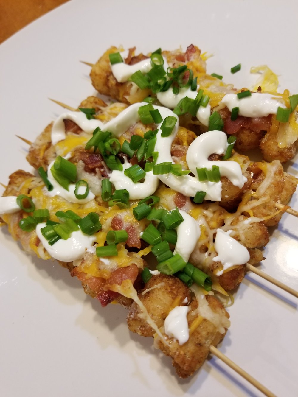 These loaded tater tots on a stick are easy to make and super delicious!