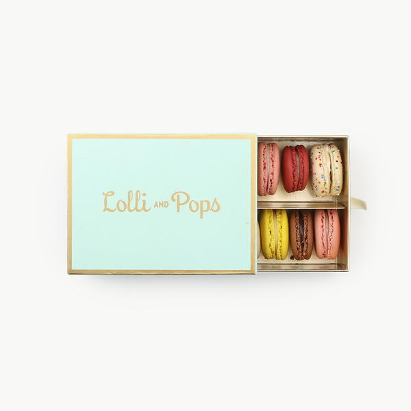 Macarons - $39 - Lolli & PopsGifting treats is the best. It's a little slice of 'you probably wouldn't buy this for yourself, so I'll buy it for you'. Macarons are our new favorite go-to, they're delicious, unexpected, and very delicious. Make a plan to grab a few boxes in advance to have on hand just-in-case or for hostess gifts.