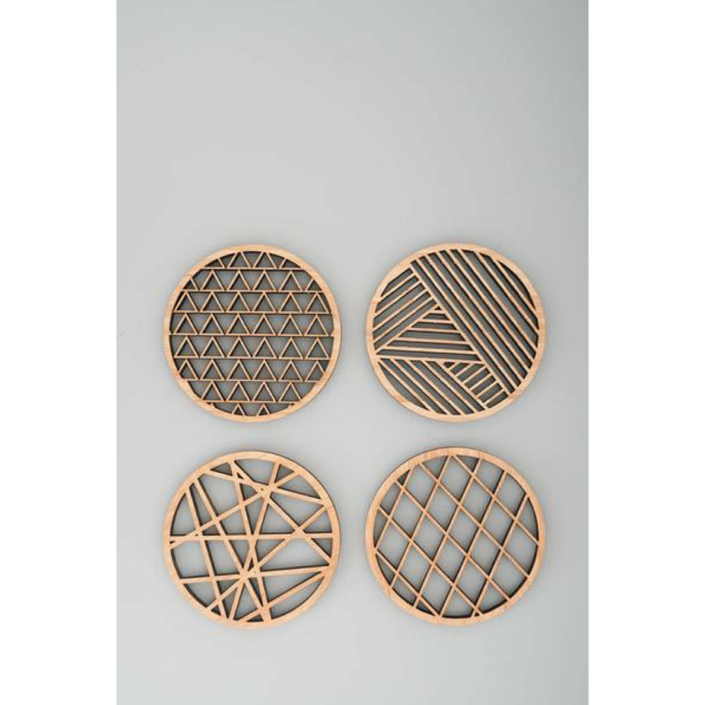 Geometric Coasters - $35 - KoromikoNothing says 'you're a grown-up' like coasters. But these say 'I'm not like a regular grown-up, I'm a cool grown-up'. These are beautiful enough you could give them to your bestie and practical enough your most basic coworker would be pleased as well.