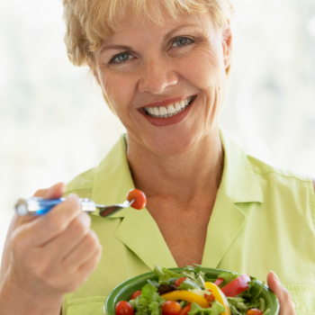 Woman eating healthy food.png