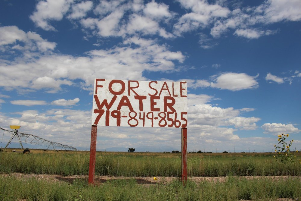 Water is a hot commodity for ranchers across Colorado.  A sign advertising a water sale sits on a farm outside Del Norte, Colorado. Luke Runyon / HARVEST PUBLIC MEDIA