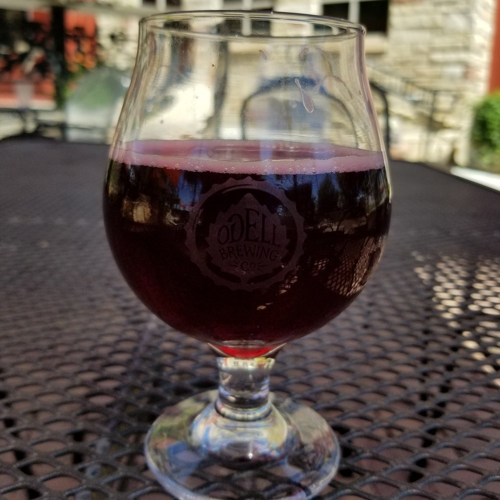 Pictured: A glass of Cold Water 1, right from the tap. It's a lightly hopped pilsner with tones of mountain sage and wild currant (where the deep red color comes from).