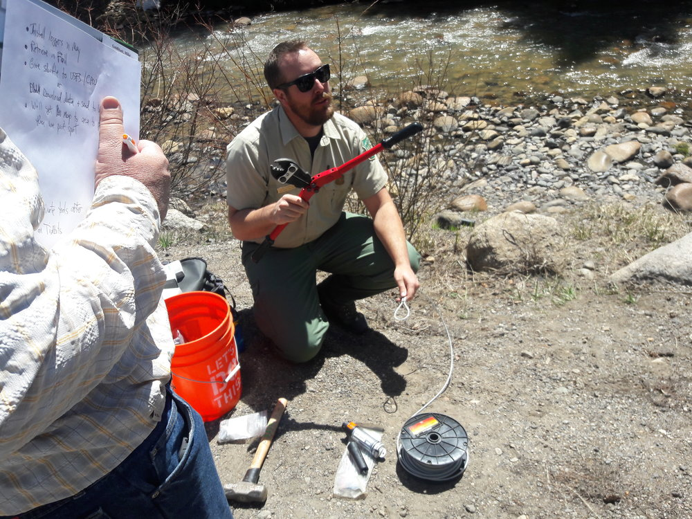 Chris Carroll, aquatic biologist with the U.S. Forest Service teaches TU volunteers how to attach stream temperature probes during April 2018 training.