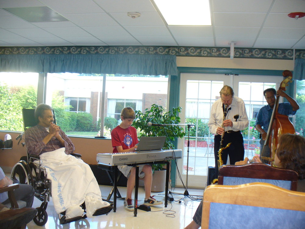 Elijah became interested in jazz after going to jam sessions at The Know Bookstore in Durham, NC and being mentored by legend Yusuf Salim. This was photo was taken in 2007 at Yusuf's retirement home shortly before his passing.