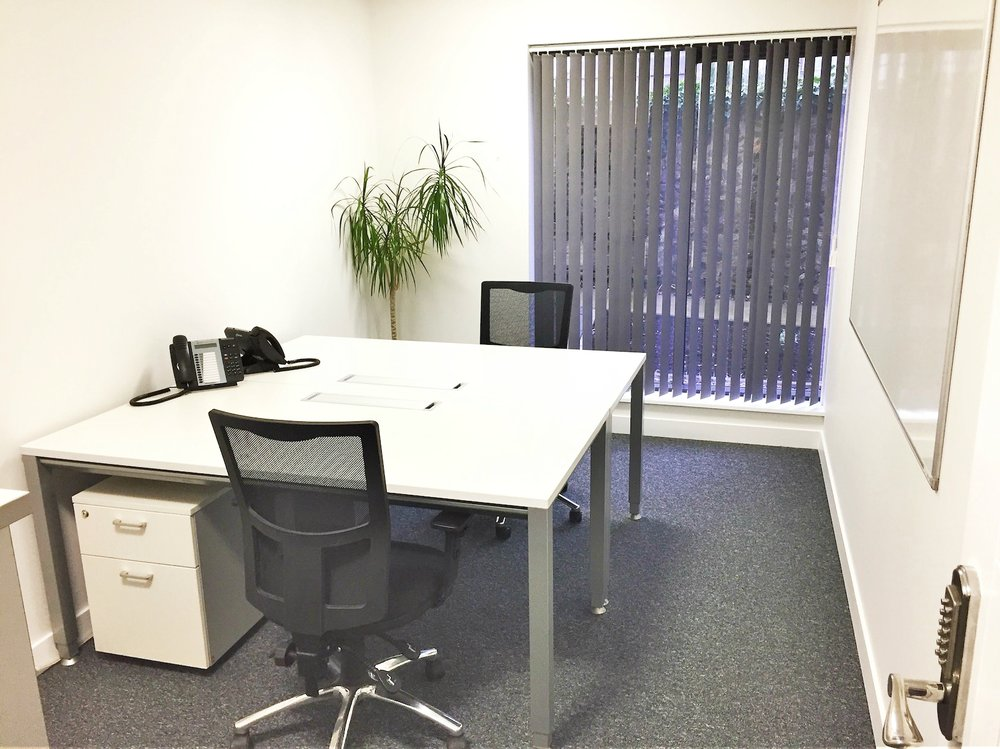 ROOM 4   A generously proportioned 2 person office of 120 square feet featuring two floor to ceiling windows affording lots of natural light, The room is furnished with 2 large desks (160x80cm) each with a pedestal unit, two ergonomic operators chairs, and a lockable Bisley storage tambour.