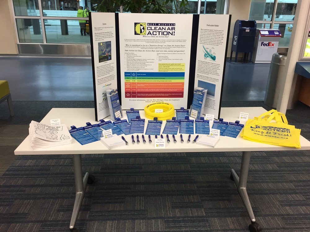 The Clean Air Action display and promotional items at the Gerald R. Ford International Airport. The display rotates throughout many city, township, and village offices, bus stations and local libraries in West Michigan during the spring and summer as well.