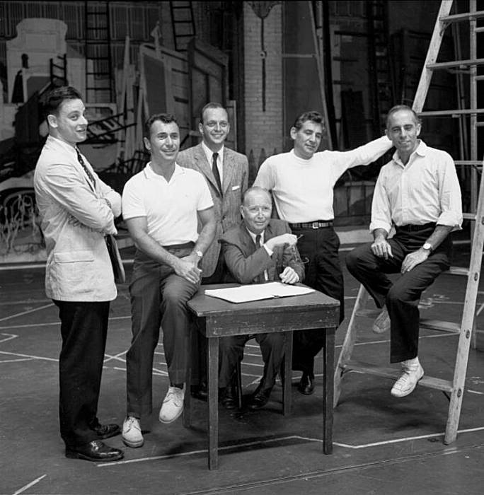 West Side Story  creative team, 1957: (left to right) lyricist Steven Sondheim, author Arthur Laurents, co-producer Hal Prince, co-producer Robert Griffith (seated), composer Leonard Bernstein, and choreographer Jerome Robbins