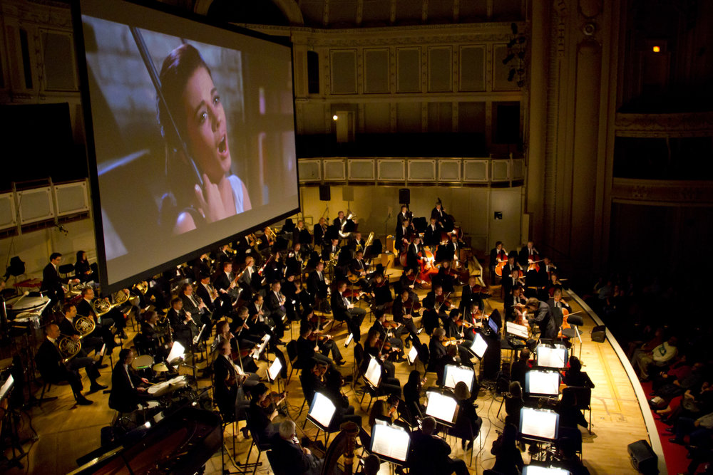 Conductor David Newman leading the Chicago Symphony Orchestra in West Side Story Film with Live Orchestra. © Todd Rosenberg Photography 2011.
