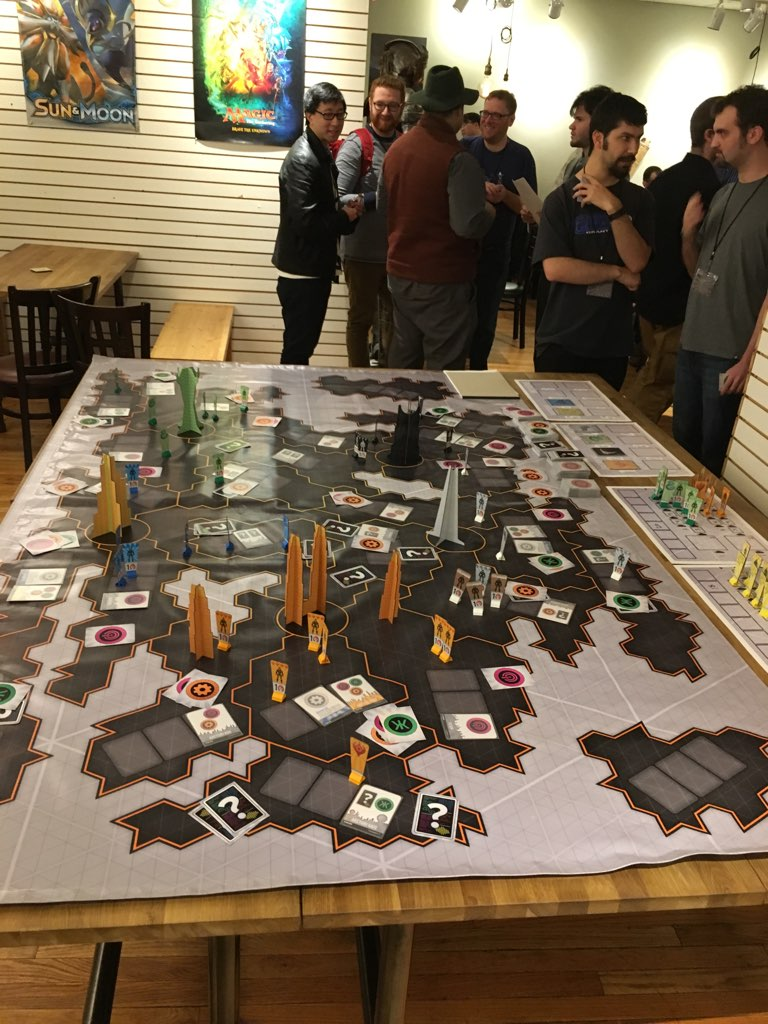 Players watch with uncertainty, discussing what to do about the invasion of mysterious spiders from space.  It's tough out there for intergalactic corporations.