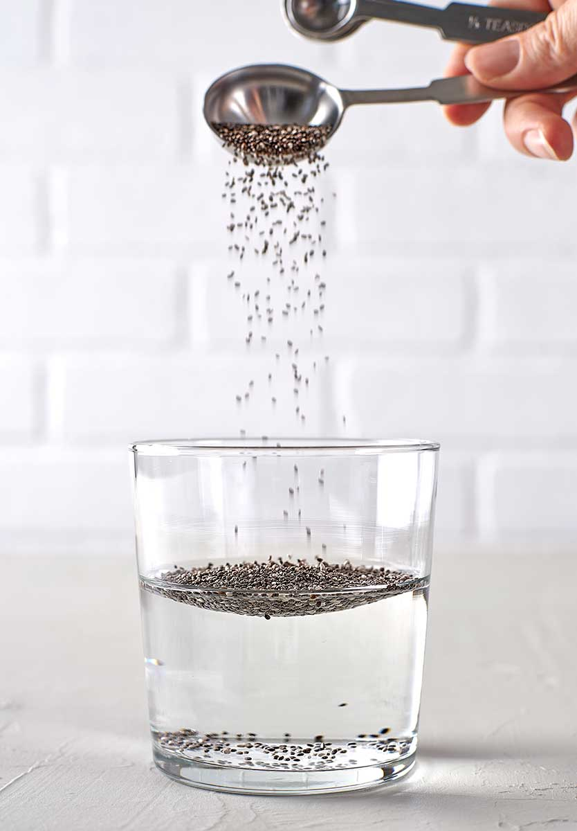 Sprinkle your chia seeds into water (I used spring water, but any clean, filtered water will do).