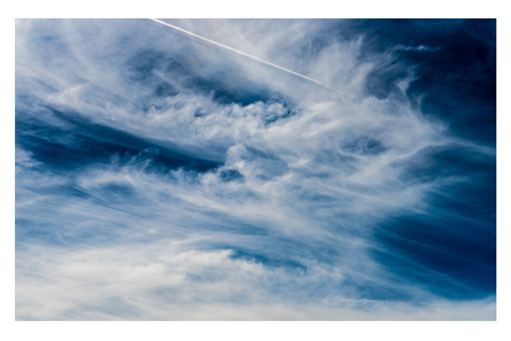 jetting through a midmorning cloudscape.jpg