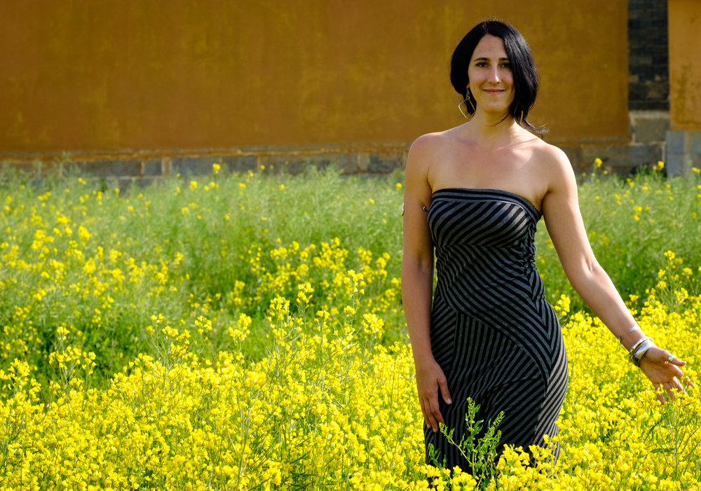 Wading through the gorgeous canola fields surrounding the Linden Centre. Photo by Frederick S. Fenyvessy