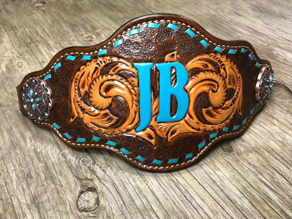 Custom Noseband - Very flashy noseband with turquoise buckstitching and lettering.