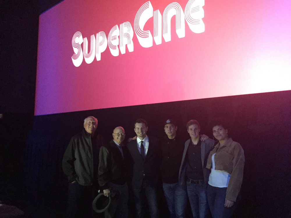 "SuperCine ""old"" and SuperCine ""new"" standing in front of the silver screen at the SMG, Simi Valley."