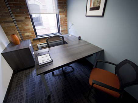single interior office with brick wall