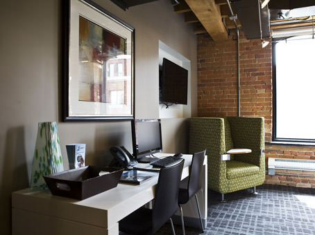 office with green chair and brick wall