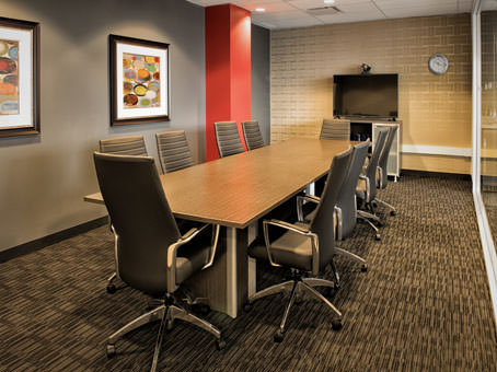 large boardroom with 10 executive chairs