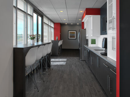lunch room area with large window and red, white, black colour scheme