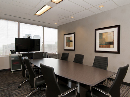 large boardroom with window and tv