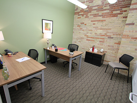large team space office with exposed brick wall