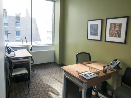 office with window city view set up for two people