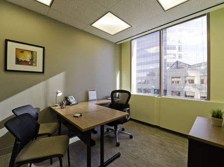 square wooden table and chair in a clear office view