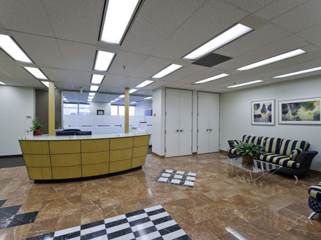 wide tiles lobby with yellow table