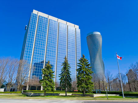 a nice and blue background with a full glass building