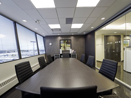 neat meeting room with a dark brown lon table
