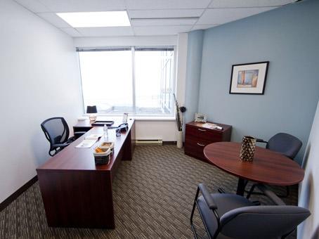 window office two desks blue walls