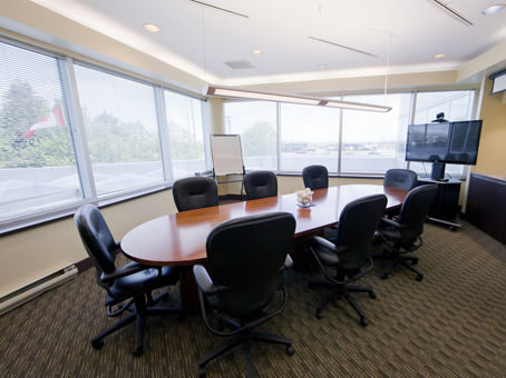 large meeting room with large windows and oval table