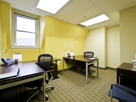 touch of yellow wall with wooden table and chairs