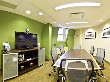 touch of green wall with long table in a meeting room