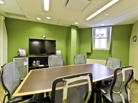 green wall with wooden table
