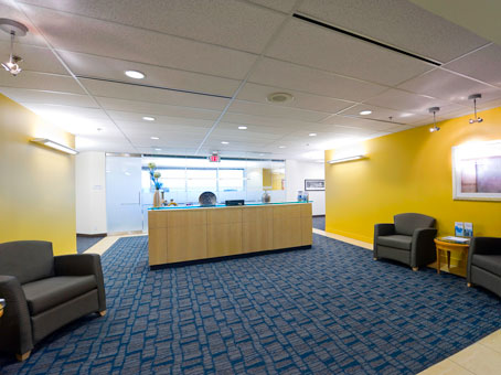wooden reception view with a yellow painted wall
