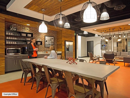 long table and chairs in an orange floor with chandelier lights