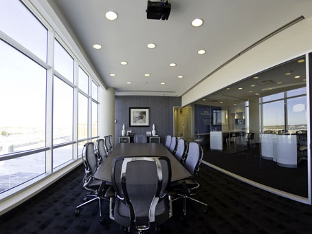 long brown table in a conference room