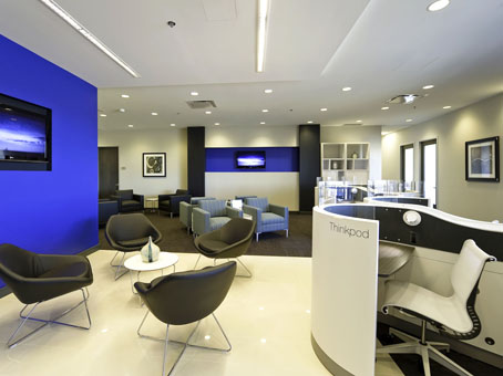 blue paited wall, white ceilling with a brown leather chairs