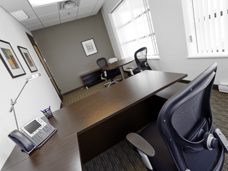 wooden table and chair in an executive office