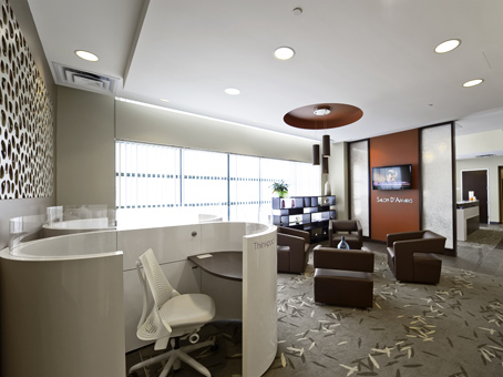 brown leather sofa in white painted wall and ceilling in a lobby