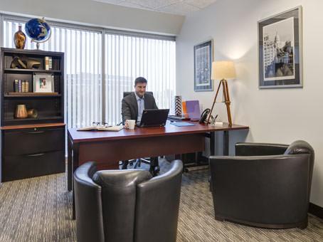 dark brown leather sofa i a nice executive room