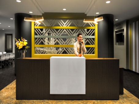 dark brown wooden table reception with a touch of yellow in thw wall